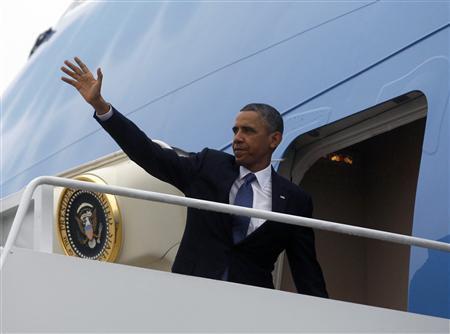President Barack Obama steps aboard Air Force one at Andrews Air Force Base near Washington, May 19, 2013. REUTERS/Jason Reed