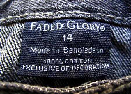 The clothing tag on a pair of jeans by Wal-Mart's brand Faded Glory, which is made in Bangladesh, is shown after purchase from a Walmart store in Encinitas, California, May 14, 2013. REUTERS/Mike Blake