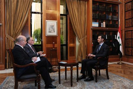 Syria's President Bashar al-Assad (R) sits during an interview with journalists from Argentina in Damascus in this handout photograph distributed by Syria's national news agency SANA on May 18, 2013. SANA/Handout via Reuters