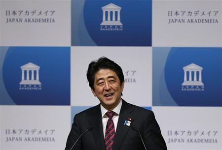 Japan's Prime Minister Shinzo Abe smiles as he delivers a speech to business leaders and scholars during a meeting hosted by Japan Akademeia in Tokyo May 17, 2013. REUTERS/Issei Kato