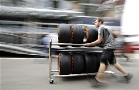 A Petronas mechanic pushes a trolley with Pirelli tires in the paddock ahead of the Spanish Formula One Grand Prix at the Circuit de Catalunya in Montmelo, near Barcelona May 9, 2013. REUTERS/Albert Gea