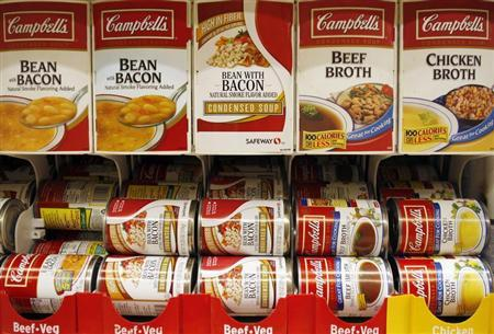 Cans of Campbell's Soup are stocked on a shelf at a grocery store in Phoenix, Arizona, February 22, 2010. REUTERS/Joshua Lott