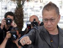 "Director Takashi Miike poses during a photocall for the film ""Wara No Tate"" (Shield of Straw) at the 66th Cannes Film Festival in Cannes May 20, 2013. REUTERS/Regis Duvignau"