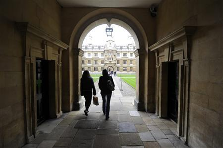 People walk into the quadrant of Clare College at Cambridge University in eastern England, in this October 23, 2010 file photo. REUTERS/Paul Hackett/Files