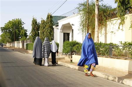 Women walk in a street in a residential area in Maiduguri, Borno State May 19, 2013, an area where President Goodluck Jonathan has declared a state of emergency. REUTERS/Afolabi Sotunde