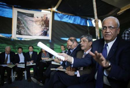 Saeb Erekat (R), a Palestinian senior politician and chief negotiator speaks during a visit to a tent set-up in protest against the construction of a road in the Arab neighbourhood of Beit Safafa in Jerusalem March 14, 2013. REUTERS/Ammar Awad