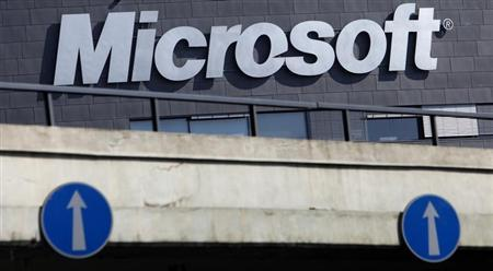 The Microsoft logo is seen on the wall of the company's branch in Prague March 17, 2013. REUTERS/David W Cerny