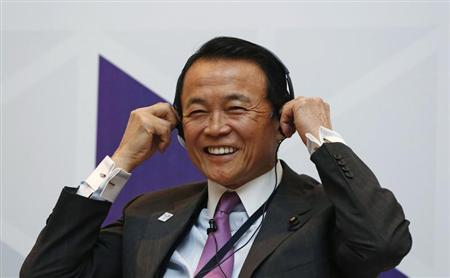 Japan's Finance Minister Taro Aso smiles as he adjusts his headphones during a seminar at the Asian Development Bank's (ADB) 46th annual board meeting in Greater Noida, on the outskirts of New Delhi May 3, 2013. REUTERS/Adnan Abidi