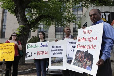 Protesters rally outside the Voice of America headquarters building before the arrival of Myanmar President Thein Sein during his visit to Washington May 19, 2013. REUTERS/Yuri Gripas