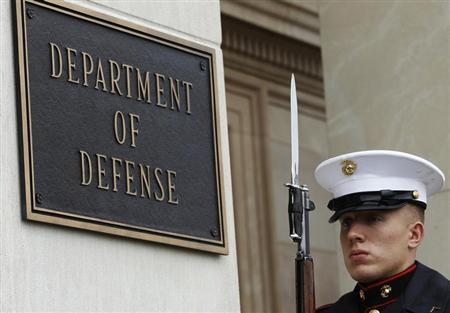 A U.S. Marine, who is part of a military honor guard, takes his position before a welcoming ceremony for German Defense Minister Thomas de Maiziere, by U.S. Defense Secretary Chuck Hagel, at the Pentagon in Washington April 30, 2013. REUTERS/Gary Cameron