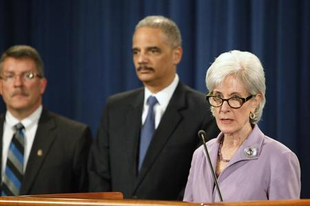 U.S. Health and Human Services Secretary Kathleen Sebelius (R) and Attorney General Eric Holder (2nd R) lead a news conference to announce Medicare Fraud Strike Force law enforcement actions at the Justice Department in Washington, May 14, 2013. REUTERS/Jonathan Ernst
