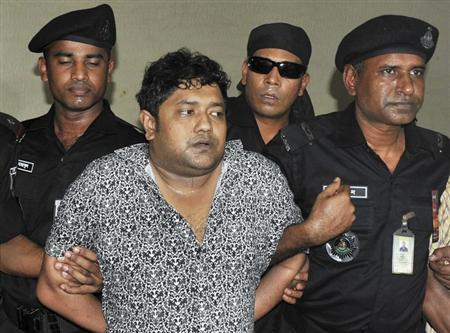 Members of the Rapid Action Battalion (RAB) present Mohammed Sohel Rana to the media after his arrest in Jessore, in Dhaka April 28, 2013. REUTERS/Stringer