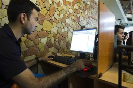 A customer uses a computer at an internet cafe in Tehran May 9, 2011. REUTERS/Raheb Homavandi/Files