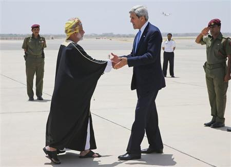U.S. Secretary of State John Kerry (3rd R) is greeted by Oman's Foreign Minister Yusuf Bin Alawi bin Abdullah (2nd L) in Muscat, May 21, 2013. REUTERS/Jim Young
