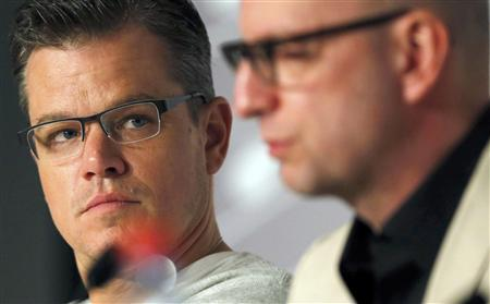 Cast member Matt Damon (L) and director Steven Soderbergh attend a news conference for the film ''Behind the Candelabra'' during the 66th Cannes Film Festival in Cannes May 21, 2013. REUTERS/Regis Duvignau