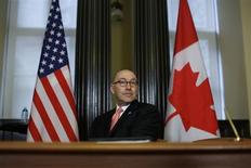 U.S. Ambassador to Canada David Jacobson takes part in a news conference with Canada's Immigration Minister Jason Kenney (not pictured) on Parliament Hill in Ottawa December 13, 2012. REUTERS/Chris Wattie
