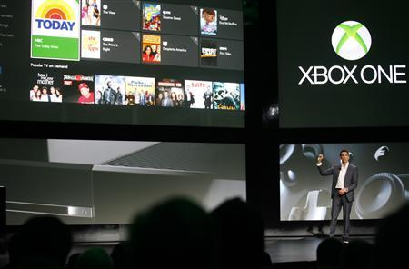 Yusuf Mehdi, senior vice president of Microsoft's Interactive Entertainment Business, discusses the Xbox One uses for television viewing during a press event in Redmond, Washington May 21, 2013. REUTERS/Nick Adams