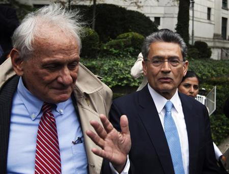 Former Goldman Sachs Group Inc board member Rajat Gupta (R) departs Manhattan Federal Court with his lawyer, Gary Naftalis (L) after being sentenced in New York, October 24, 2012. REUTERS/Lucas Jackson/Files