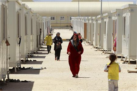 Syrian refugees walk inside the Mrajeeb Al Fhood refugee camp, 20 km (12.4 miles) east of the city of Zarqa April 29, 2013. REUTERS/Muhammad Hamed