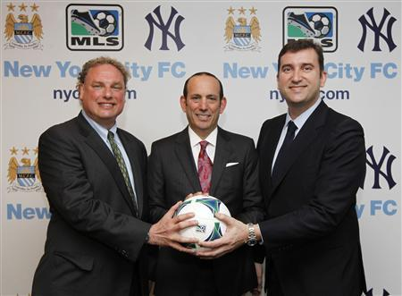 New York Yankees President Randy Levine, Major League Soccer Commissioner Don Garber, and CEO of Manchester City FC Ferran Soriano (L-R) smile during a press announcement in New York, in this photo courtesy of MLS Soccer taken May 21, 2013. Courtesy of MLS Soccer/Handout via Reuters