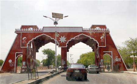 Vehicles drive through the city gate located along Jos Road, after the military declared a 24-hour curfew over large parts of Maiduguri in Borno State May 19, 2013. REUTERS/Afolabi Sotunde