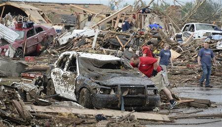 A damaged police car is seen after a tornado struck Moore, Oklahoma, May 20, 2013. REUTERS/Gene Blevins