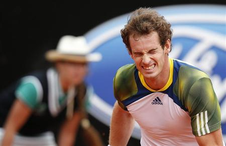 Andy Murray of Britain reacts during the men's singles match against Marcel Granollers of Spain at the Rome Masters tennis tournament May 15, 2013. REUTERS/Tony Gentile