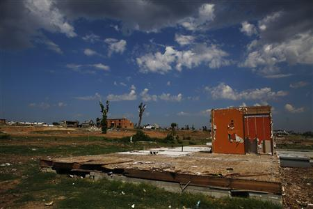 General view of a landscape almost cleared of debris in Joplin, Missouri August 16, 2011. REUTERS/Eric Thayer