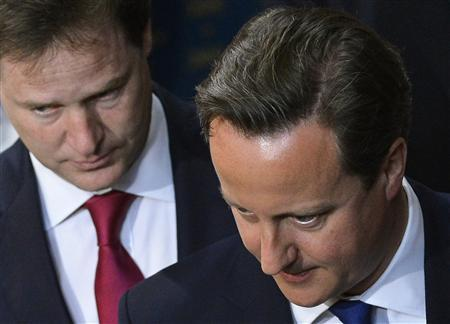 Britain's Prime Minister David Cameron (R) and deputy prime minister Nick Clegg attend the State Opening of Parliament, in the House of Lords at the Palace of Westminster in London May 8, 2013. REUTERS/Toby Melville (POLITICS) - RTXZETA