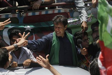 Imran Khan, Pakistani cricketer-turned-politician and chairman of political party Pakistan Tehreek-e-Insaf (PTI), cheers his supporters after his visit to the mausoleum of Mohammad Ali Jinnah, founder and first governor-general of Pakistan, during an election campaign in Karachi May 7, 2013. REUTERS/Athar Hussain