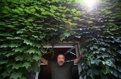 Dissident Chinese artist Ai Weiwei stands at the door to his studio in Beijing, May 22, 2013. REUTERS/Petar Kujundzic