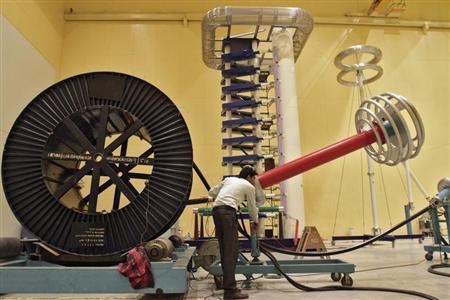 An employee works inside the power cable testing laboratory in Rajasthan August 6, 2012. REUTERS/B Mathur/Files