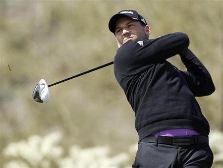Spanish golfer Sergio Garcia hits off the 17th tee against Thailand's Thongchai Jaidee during the weather delayed first round of the WGC-Accenture Match Play Championship golf tournament in Marana, Arizona, February 21, 2013. REUTERS/Ralph Freso