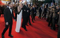 "Director Ethan Coen (L), cast member Carey Mulligan (2ndL), musician T-Bone Burnett (3rdL) walk on the red carpet as they leave after the screening of the film ""Inside Llewyn Davis"" in competition during the 66th Cannes Film Festival in Cannes May 19, 2013. REUTERS/Regis Duvignau"