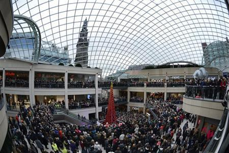 Shoppers watch the opening ceremony at the Trinity Leeds shopping centre in Leeds, northern England March 21, 2013. REUTERS/Nigel Roddis