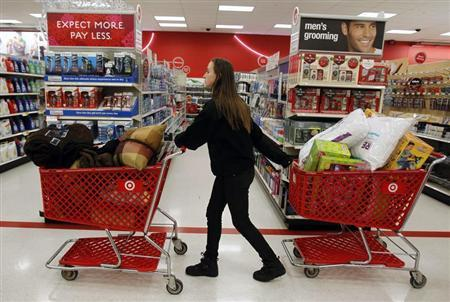 A woman pulls shopping carts through the aisle of a Target store on the shopping day dubbed ''Black Friday'' in Torrington, Connecticut November 25, 2011. REUTERS/Jessica Rinaldi