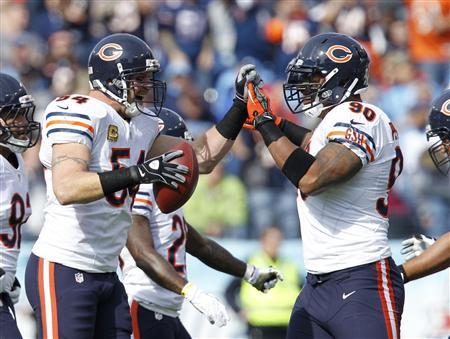 Chicago Bears line backer Brian Urlacher (54) celebrates with defensive end Julius Peppers (90) after recovering a fumble in the first half of their NFL football game against the Tennessee Titans in Nashville, Tennessee November 4, 2012. REUTERS/Harrison McClary