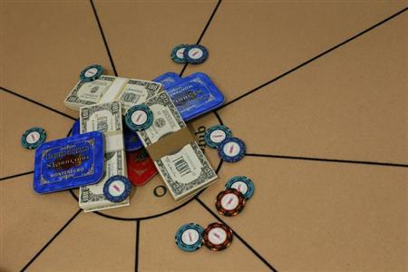 Poker chips are seen on a table in London September 28, 2012 in this file photo. REUTERS/Stefan Wermuth