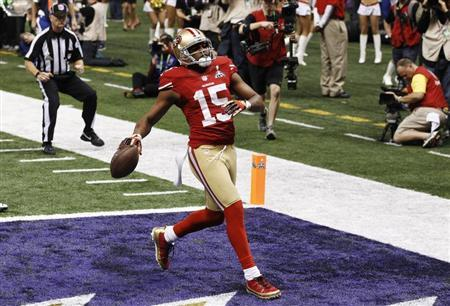 San Francisco 49ers wide receiver Michael Crabtree scores a touchdown against the Baltimore Ravens during the third quarter in the NFL Super Bowl XLVII football game in New Orleans, Louisiana, February 3, 2013. REUTERS/Jim Young