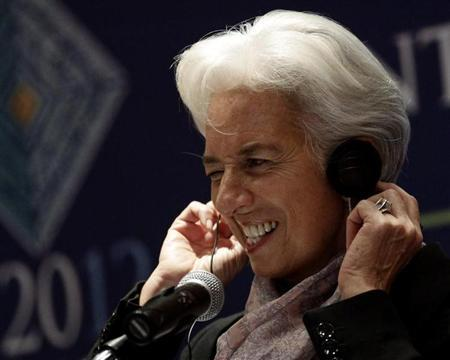 International Monetary Fund (IMF) Managing Director Christine Lagarde adjusts her headphones as she listens to a question on the second day of the G20 at a hotel in Mexico City November 5, 2012. REUTERS/Henry Romero