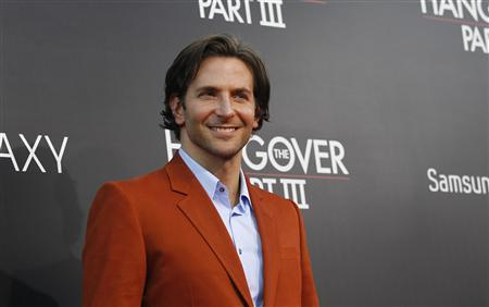 Cast member Bradley Cooper poses at the premiere of ''The Hangover Part III'' at the Westwood Village theatre in Los Angeles, California May 20, 2013. REUTERS/Mario Anzuoni