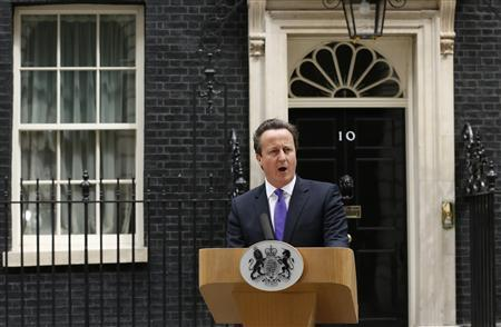 Britain's Prime Minster David Cameron speaks in front of 10 Downing Street, about the killing of a British soldier, in London May 23, 2013. REUTERS/Olivia Harris
