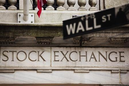 A street sign for Wall Street hangs in front of the New York Stock Exchange May 8, 2013. REUTERS/Lucas Jackson