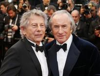 "Director Roman Polanski (L) and former Formula One champion driver Jackie Stewart of Britain pose on the red carpet as they arrive for the screening of the film ""All is Lost"" during the 66th Cannes Film Festival in Cannes May 22, 2013. REUTERS/Yves Herman"