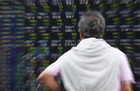 A man looks at an electronic stock quotation board outside a brokerage in Tokyo May 23, 2013. REUTERS/Toru Hanai
