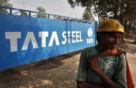 A labourer stands outside a Tata Steel stockyard in Chandigarh May 23, 2013. REUTERS/Ajay Verma