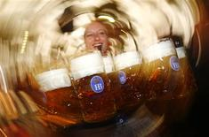 "File picture shows a waitress using a whistle to free her way while carrying traditional one-litre ""Masskrug"" beer mugs at the opening day of the Munich Oktoberfest at the Theresienwiese in Munich, September 22, 2012. REUTERS/Kai Pfaffenbach/Files"