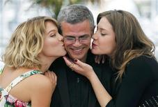 "Cast members Lea Seydoux (L) and Adele Exarchopoulos (R) kiss director Abdellatif Kechiche (C) as they pose during a photocall for the film ""La Vie D'Adele"" at the 66th Cannes Film Festival in Cannes May 23, 2013. REUTERS/Regis Duvignau"
