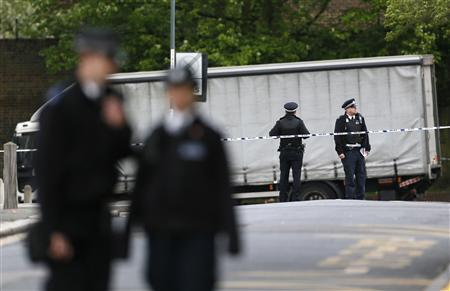 Police officers guard a cordon set up around a crime scene where one man was killed in Woolwich, southeast London May 22, 2013. REUTERS/Stefan Wermuth