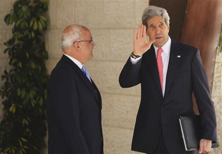 U.S. Secretary of State John Kerry (R) waves as he stands next to Palestinian Chief Negotiator Saeb Erekat before his meeting with Palestinian President Mahmoud Abbas in the West Bank city of Ramallah May 23, 2013. REUTERS/Fadi Arouri/Pool